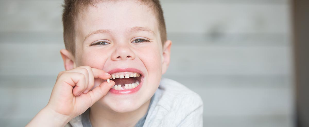 little boy with lost tooth